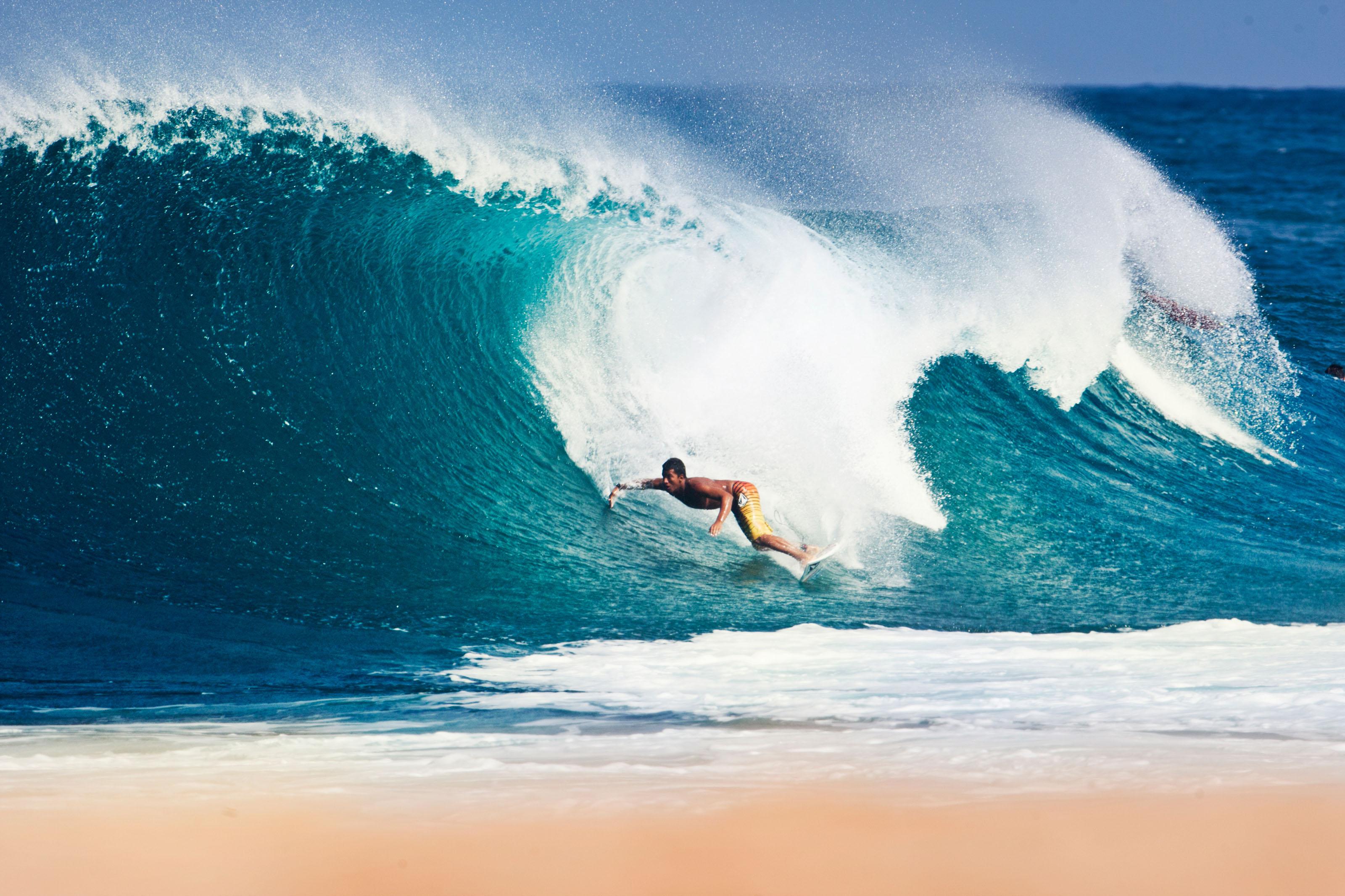 Carlos Munos surfing in Hawaii