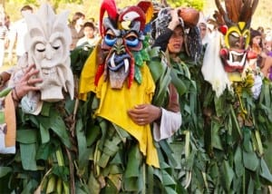 Boruca diablitos camouflaged with banana leaves and masks