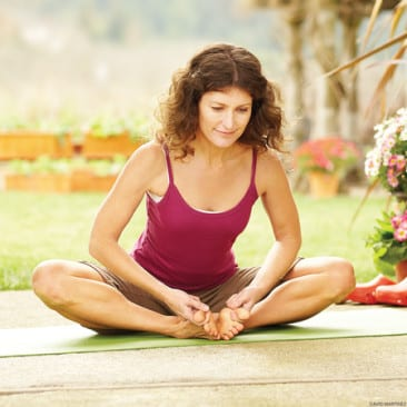 Top tips for easing travel stress with yoga