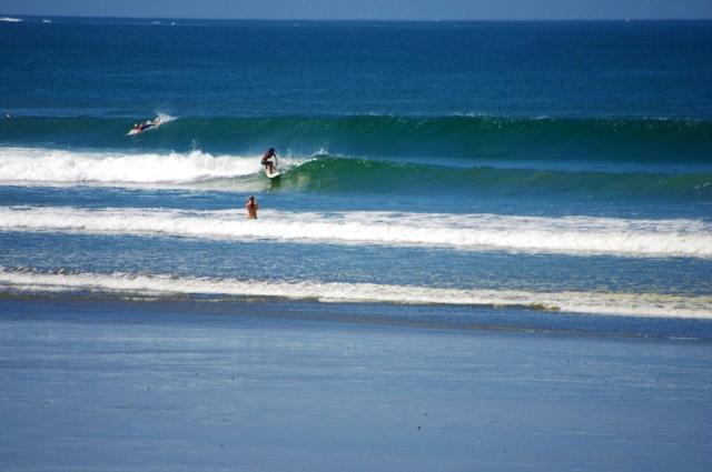 Surfing Playa Guiones, Nosara, Costa Rica