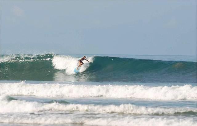 Surfing the waves at Santa Teresa, Costa Rica