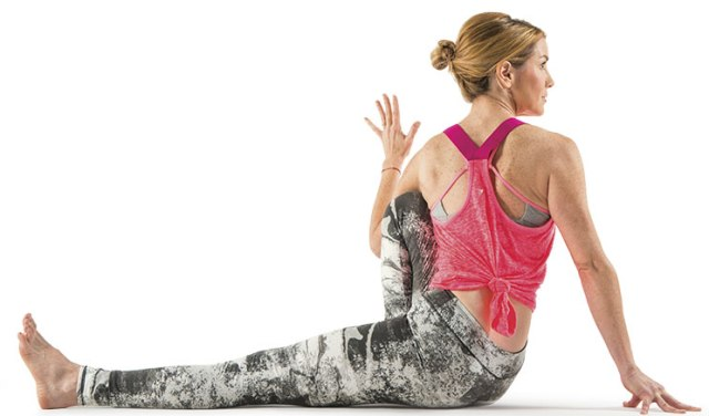 Yoga pose Seated Twist, image by Yoga Journal