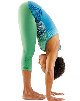 Yoga pose Standing forward bend, image by Yoga Journal