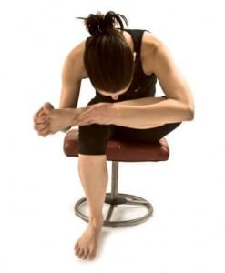 Yoga pose seated thread the needle