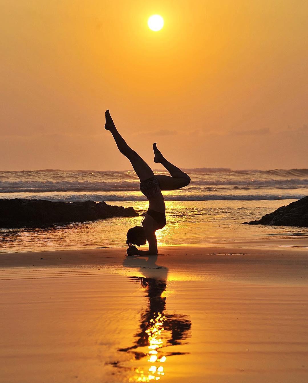 Yoga and sunsets at Santa Teresa beach, photo credit @nancygoodfellowyoga.