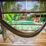 Hammock time at Pranamar Oceanfront Villas and Yoga Retreat, photo credit pranamarvillas.