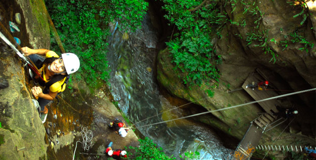 Adventure tour zip lining at Hacienda Guachipelin in Costa Rica