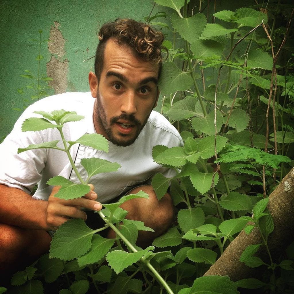 Luciano at his herb garden, photo by lucianoriotti.