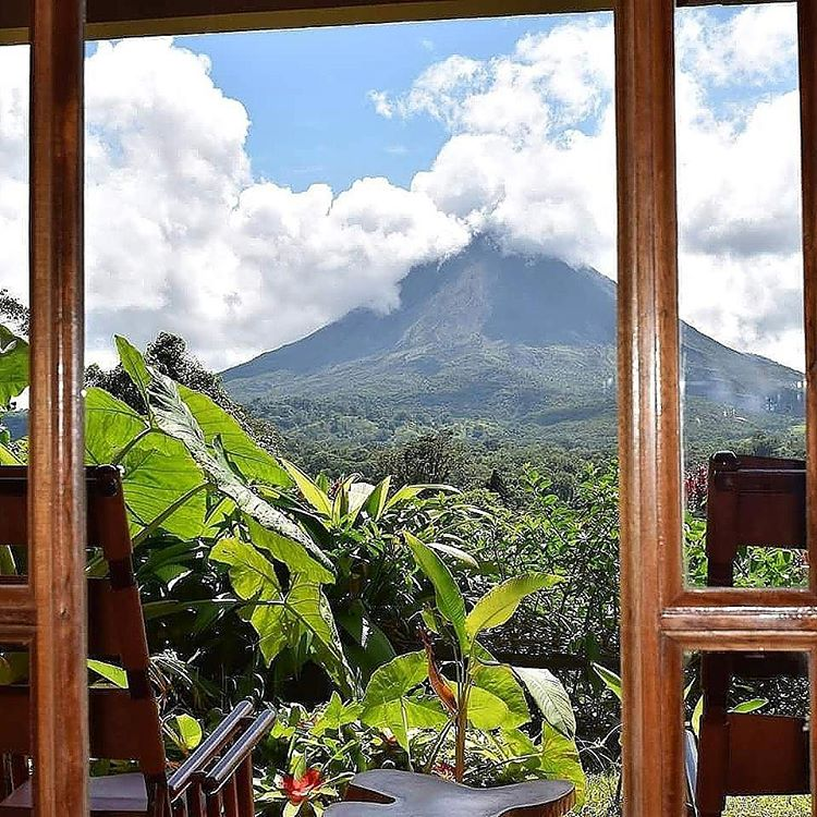 View of Arenal Volcano from Lost Iguana Resort, photo credit lostiguanaresort