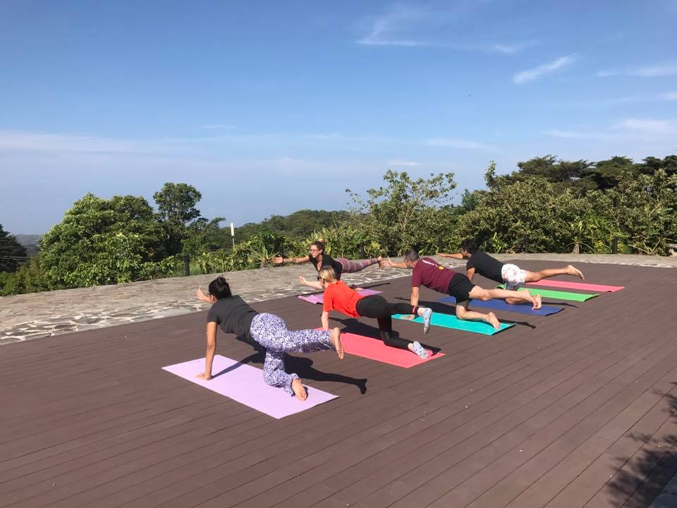 Inaugural yoga class at El Establo Mountain Hotel enjoys the view.