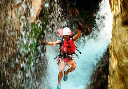 Adventure tour waterfall canyoning at Hacienda Guachipelin